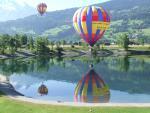 Landing of the hot air balloon close the Passy Lake