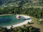 hot air balloon and shadow on the lake